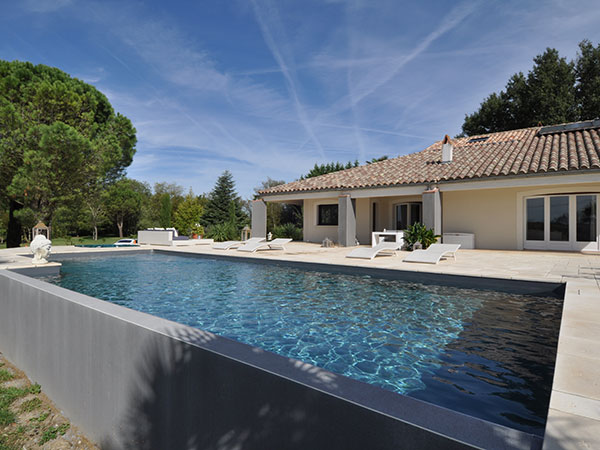 Piscine hors sol beton pas cher for Construction piscine inox